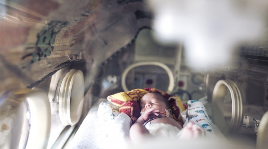 An infant in an incubator