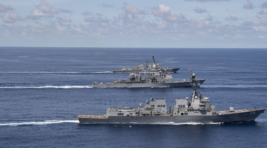 U.S. Navy and Indian Navy ships steam in formation in the Indian Ocean.