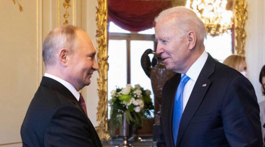 Biden and Putin shaking hands