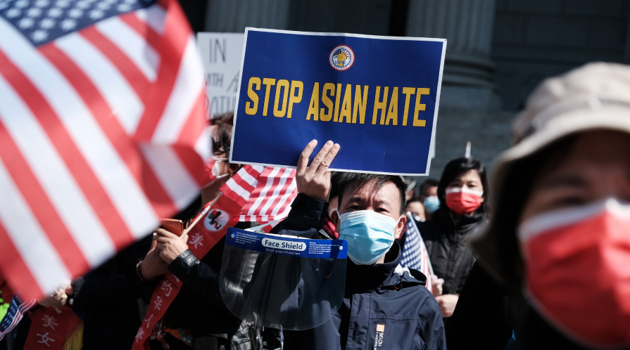 A man holds a 'Stop Asian Hate' sign during a rally protesting rising violence against Asian Americans.