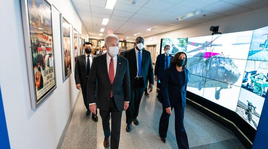 President Joe Biden walks with Vice President Kamala Harris and Secretary of Defense Lloyd Austin.