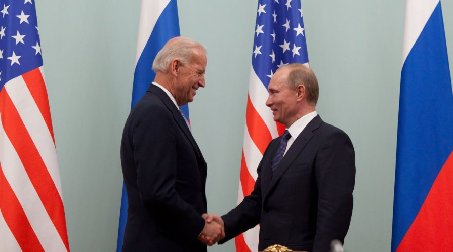 Joe Biden shaking hands with Vladimir Putin