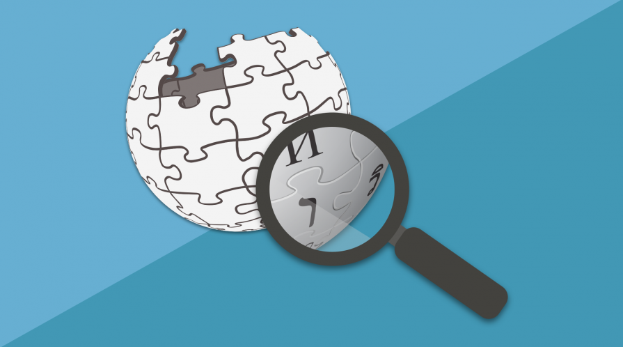 magnifying glass hovering over Wikipedia logo