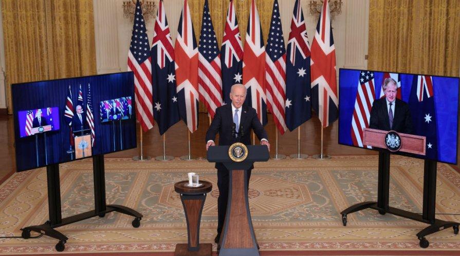 Joe Biden speaks during an event in the White House September 15, 2021 in Washington, DC. President Biden announced a new national security initiative in partnership with Australian Prime Minister Scott Morrison (L) and UK Prime Minister Boris Johnson
