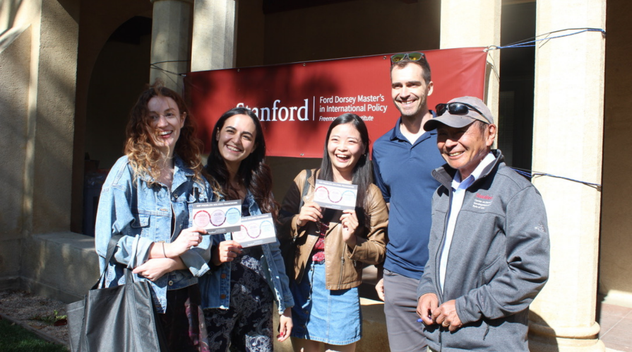 Students stand with Francis Fukuyama, the Director of the Ford Dorset Master's in International Policy.