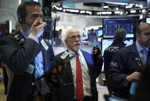 Traders and financial professionals work at the opening bell on the floor of the New York Stock Exchange (NYSE), May 6, 2019