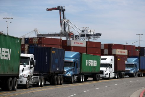 Trucks line up to enter a shipping berth at the Port of Oakland