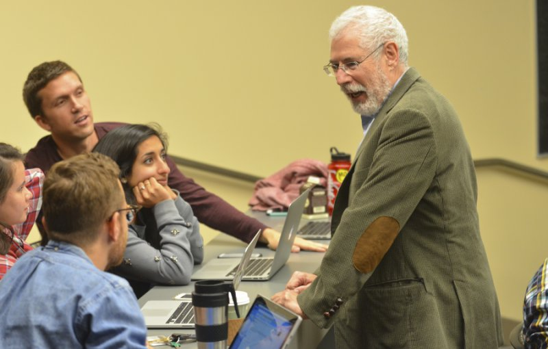 Startup guru Steve Blank shares a light moment with a group of students.