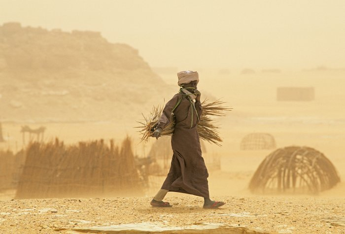 A man walks through a sandstorm in Chad