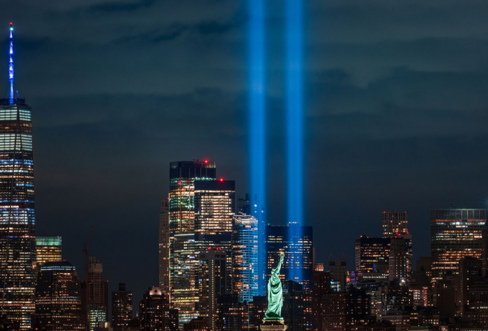 Pillars of light are projected from the 9/11 Memorial Site where the Twin Towers used to stand in New York CIty.