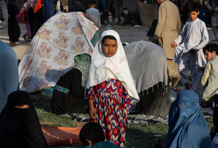 Displaced Afghans are seen at a makeshift IDP camp in Kabul.