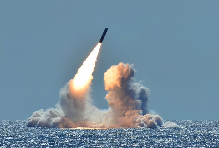 rocket launched over the ocean