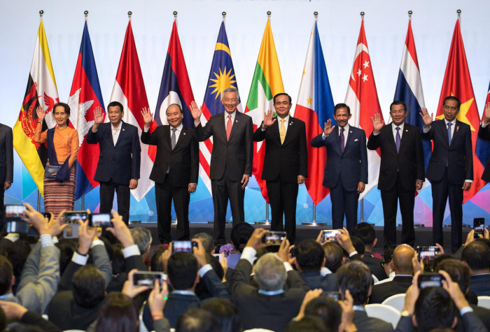 Leaders from the ASEAN league gather onstage at the 33rd ASEAN Summit in 2018 in Singapore.