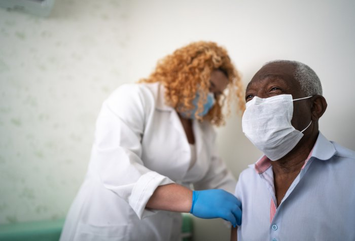 African American gets vaccinated