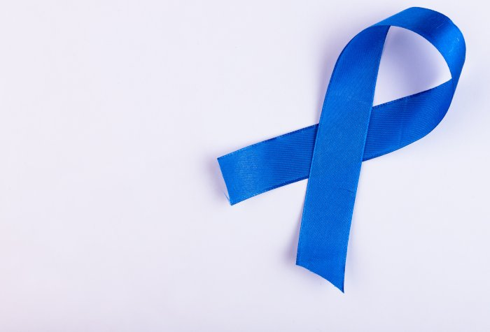 A blue ribbon represents colon cancer awareness.
