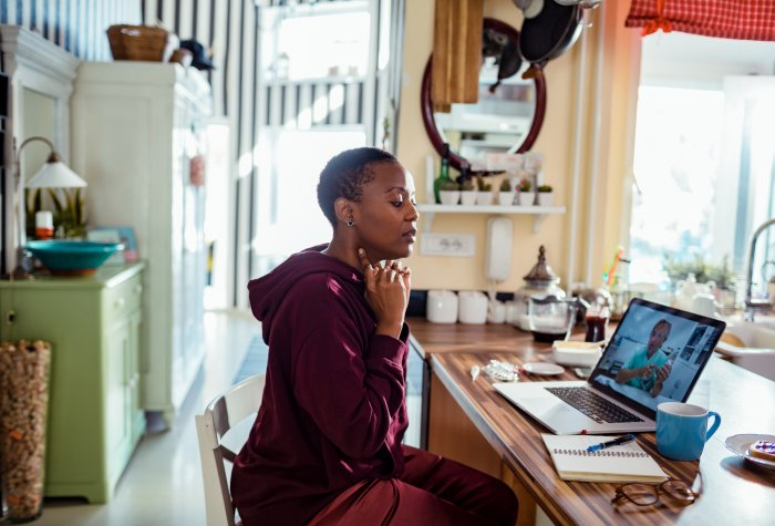 A woman gets a consultation through telemedicine call with physician.