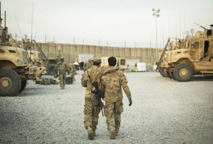 Two soldiers walking away