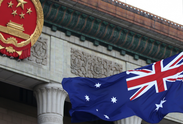 The Australian flag flies outside the Great Hall of the People in Beijing