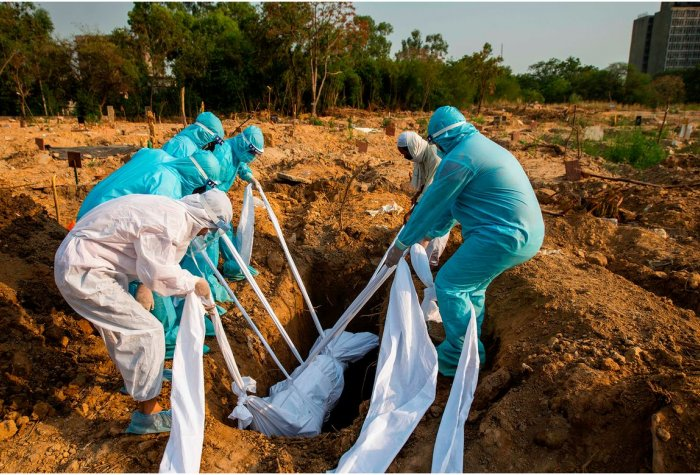 People in suits burying a body