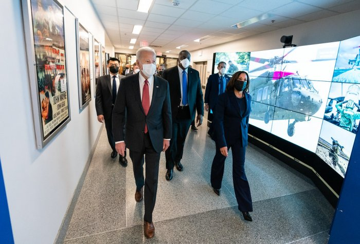 President Joe Biden walks with Vice President Kamala Harris and Secretary of Defense Lloyd Austin.