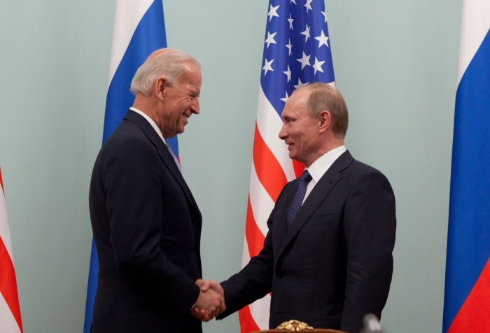 Joe Biden shaking hands with Vladimir Putin