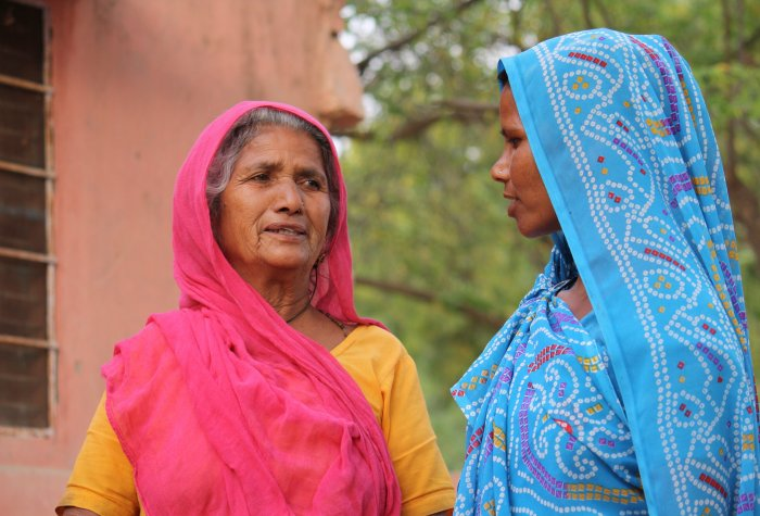 Two women standing in a street in Rajasthan, India