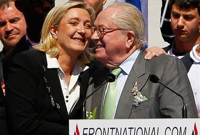 National Front politician Marine Le Pen hugs her father, Jean Marie le Pen