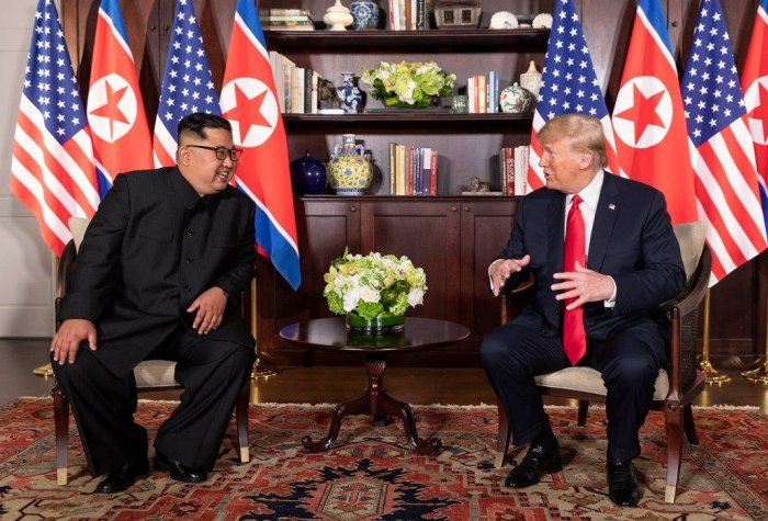 President Trump and Chairman Ki talking during Sinapore Summit