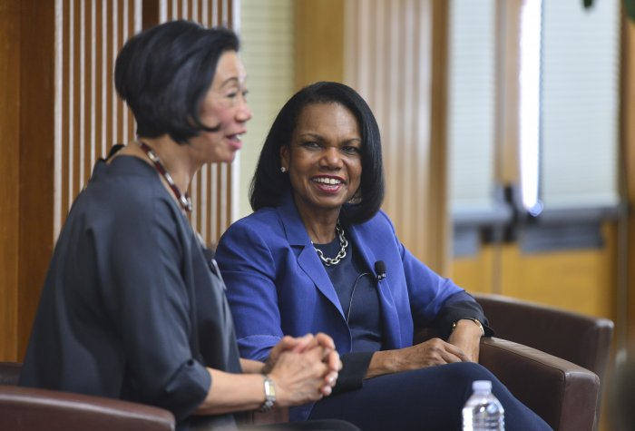 Jean Oi speakin as Codoleezza Rice listens on