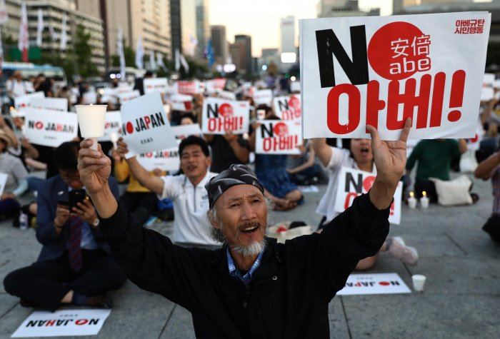 South Koreans participate in a rally to denounce Japan's new trade restrictions and Japanese Prime Minister Shinzo Abe on August 24, 2019 in Seoul, South Korea.