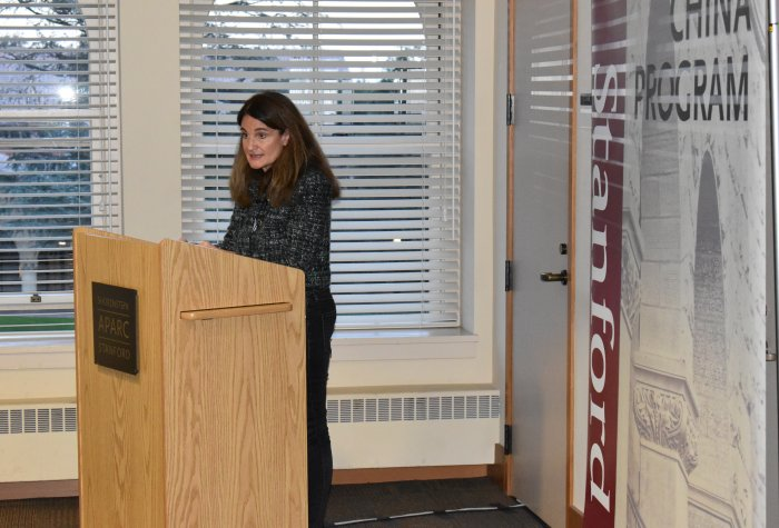 Elizabeth Economy speaking at a podium