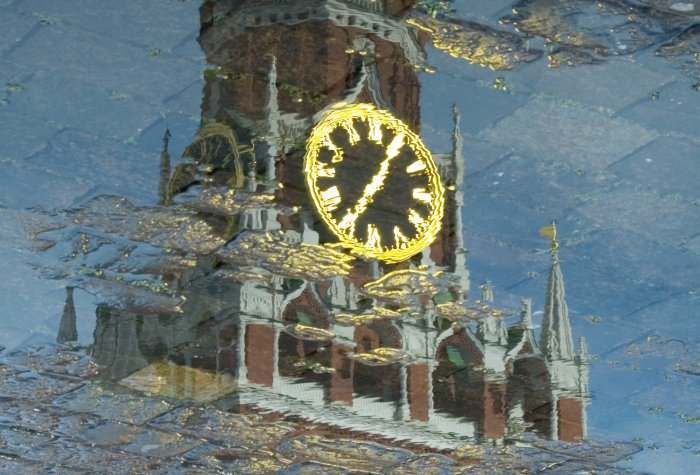 Reflection in pool of Spasskaya tower of Moscow Kremlin