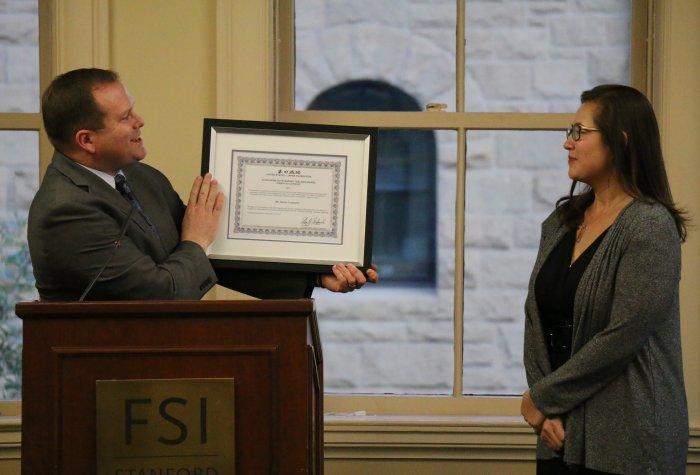 David Janes presents the 2017 Elgin Heinz Teacher Award to Naomi Funahashi