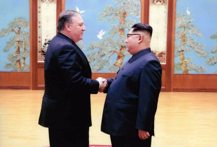 Secretary of State Mike Pompeo shakes hands with North Korean leader Kim Jon-un