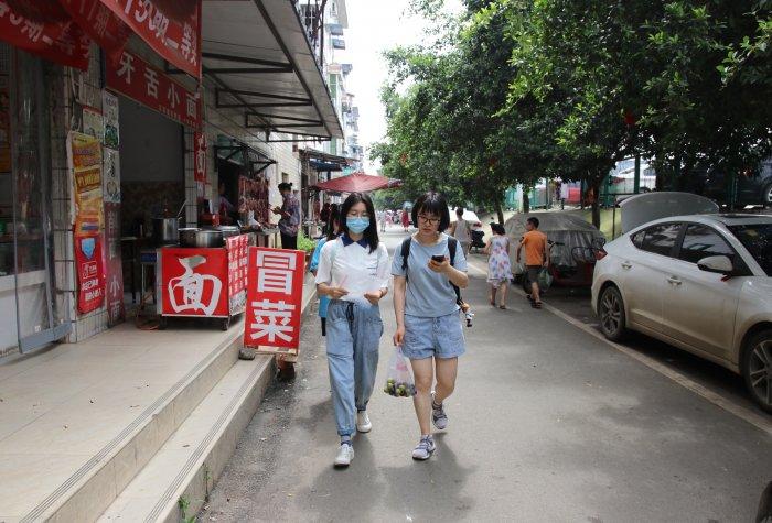 REAP researchers walking on a new road between interviews in Chengdu.