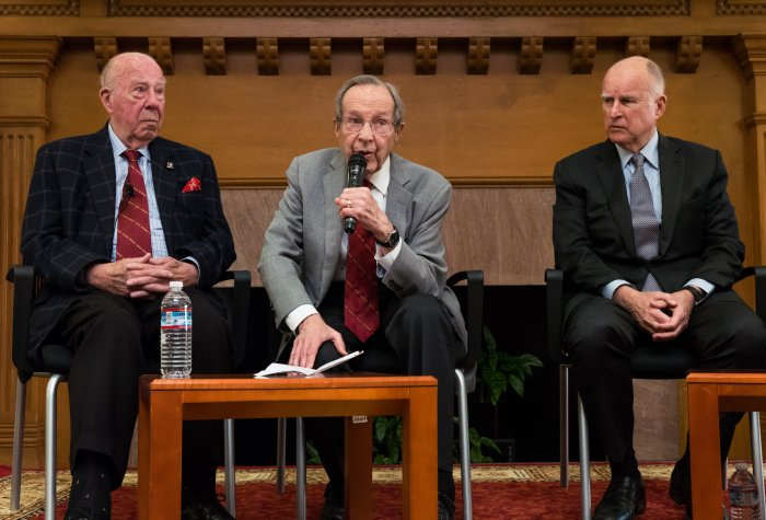 """Former U.S. Secretary of Defense William J. Perry (center) speaks at a press conference announcing the Bulletin of Atomic Scientists' latest """"doomsday clock"""" estimates, as former U.S. Secretary of State George P. Shultz (left) and California Governor Jerr"""