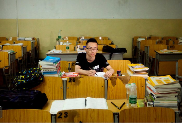 A Chinese college student studies for his exams