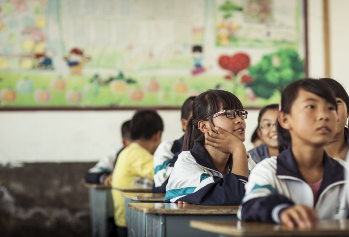 A Chinese girl with glasses provided by Smart Focus, a social enterprise spun out from Stanford and REAP that restores vision to children in rural China.