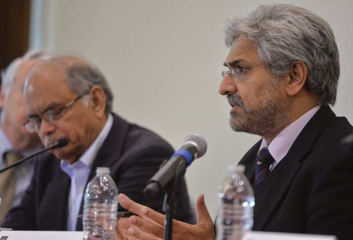 Siddharth Varadarajan speaking on a panel, seated next to Nayan Chanda.