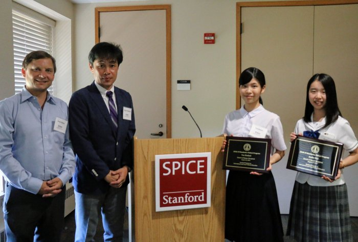 High school student honorees Yua Kodani and Ayaka Ikei with Jonas Edman and Takuya Fukushima at the inaugural Stanford e-Tottori Day.