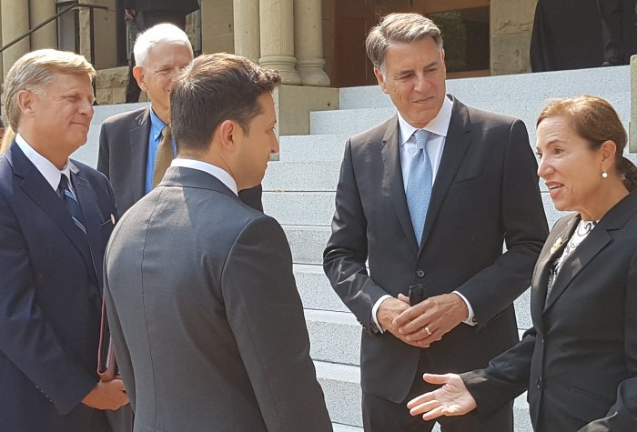 President Volodymyr Zelensky of Ukraine speaks with Markos Kounalakis and Lieutenant Governor Eleni Kounalakis.