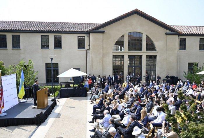President Volodymyr Zelensky of Ukraine addresses an audience in the Encina Courtyard of the Freeman Spogli Institute for International Studies at Stanford University.