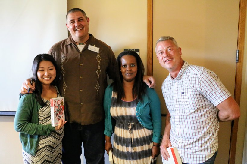 "Professor Adam Johnson poses with happy teachers after signing their new copies of ""The Orphan Master's Son"" at the 2017 East Asia Summer Institute."