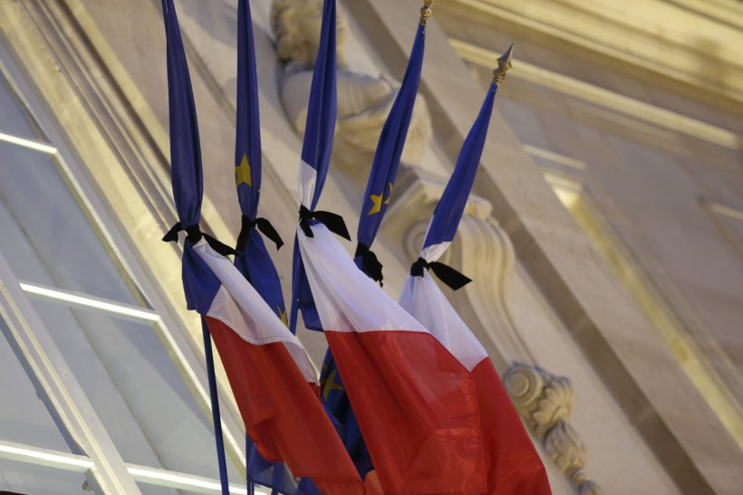 French flags tied with black tissue at the Elysee Palace in a sign of mourning in Paris January 8, 2015