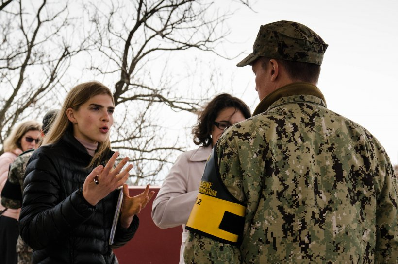 Student Isabelle Foster asks Lieutenant Commander Daniel McShane about his time defending the DMZ as they stand on a platform overlooking North Korea. Photo by Nicole Feldman.