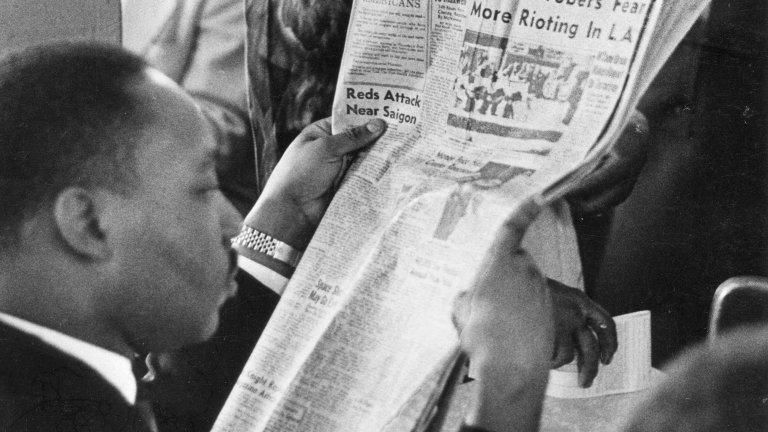 Martin Luther King reading paper