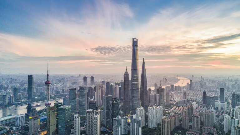 Aerial view of Shanghai, China financial district with sunrise.
