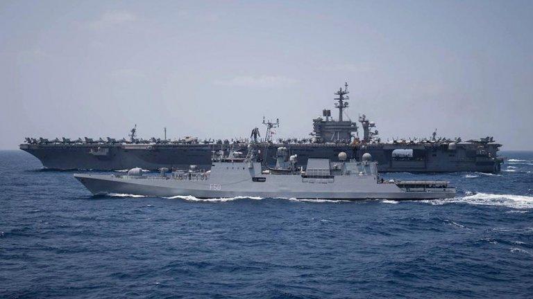 The Indian Navy Talwar-class frigate INS Tarkash (F50) transits alongside the aircraft carrier USS Theodore Roosevelt (CVN 71) during a passing exercise with the Theodore Roosevelt Carrier Strike Group, Indian Ocean, March 2018