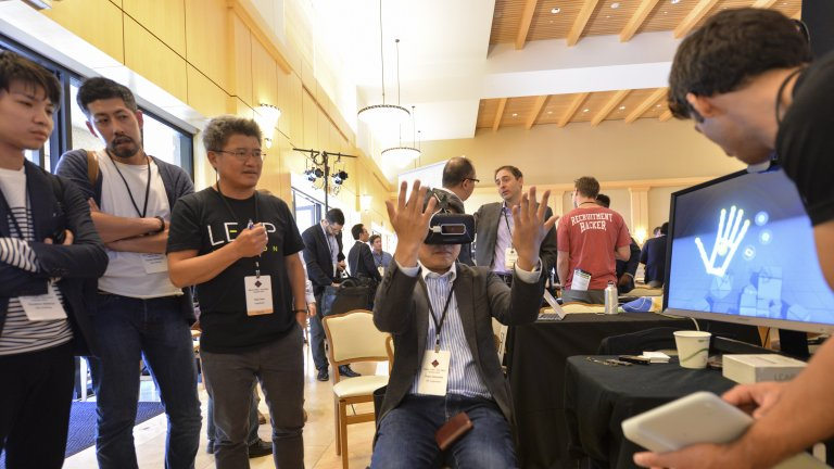 Students and faculty experiencing VR devices at Stanford