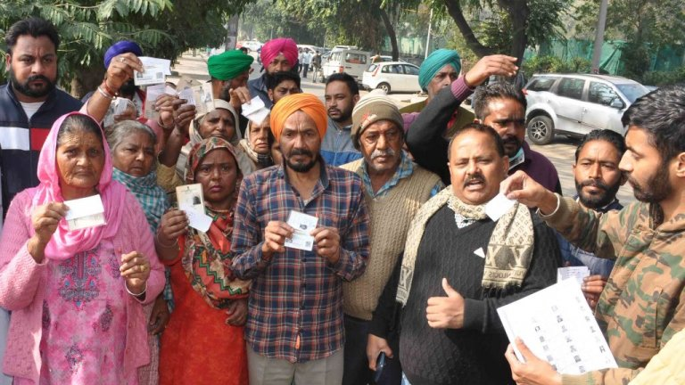Voters protest outside a polling station at Phase 9 during the Punjab Municipal Election at St Soldier School on February 14, 2021 in Mohali, India.